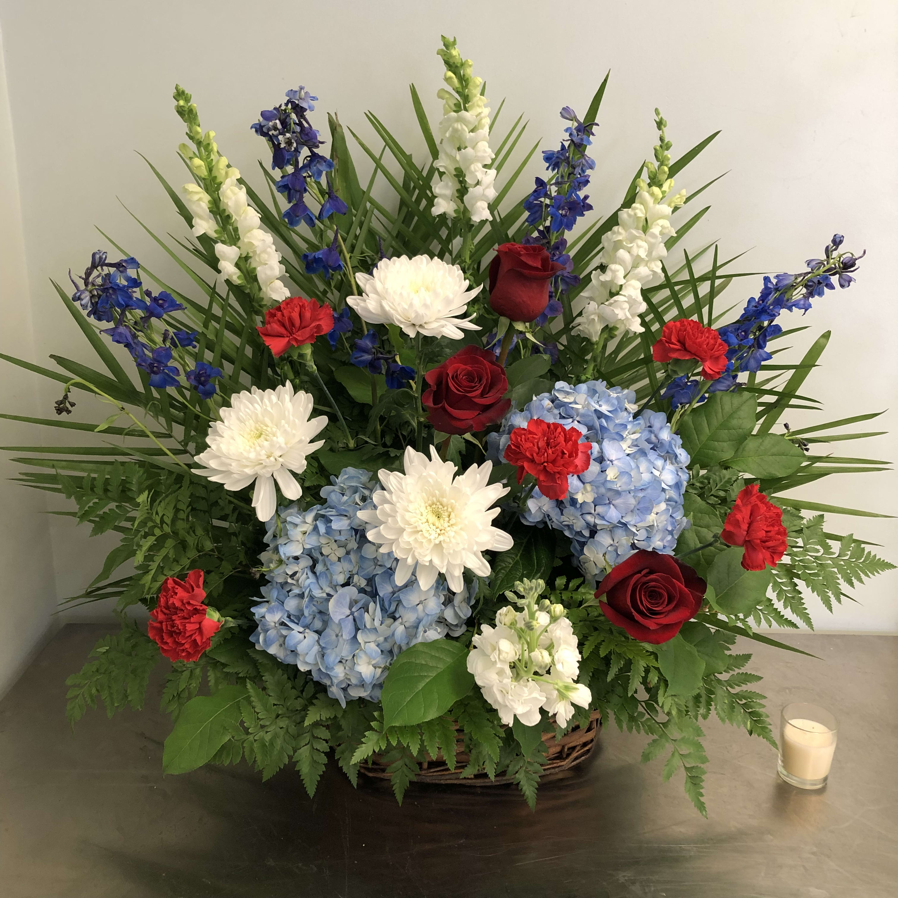 Red White And Blue Wicker Funeral Basket By Evans Flowers