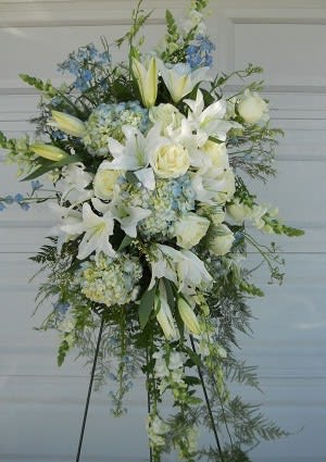 Light Blue White Easel Arrangement By Petal People Florist