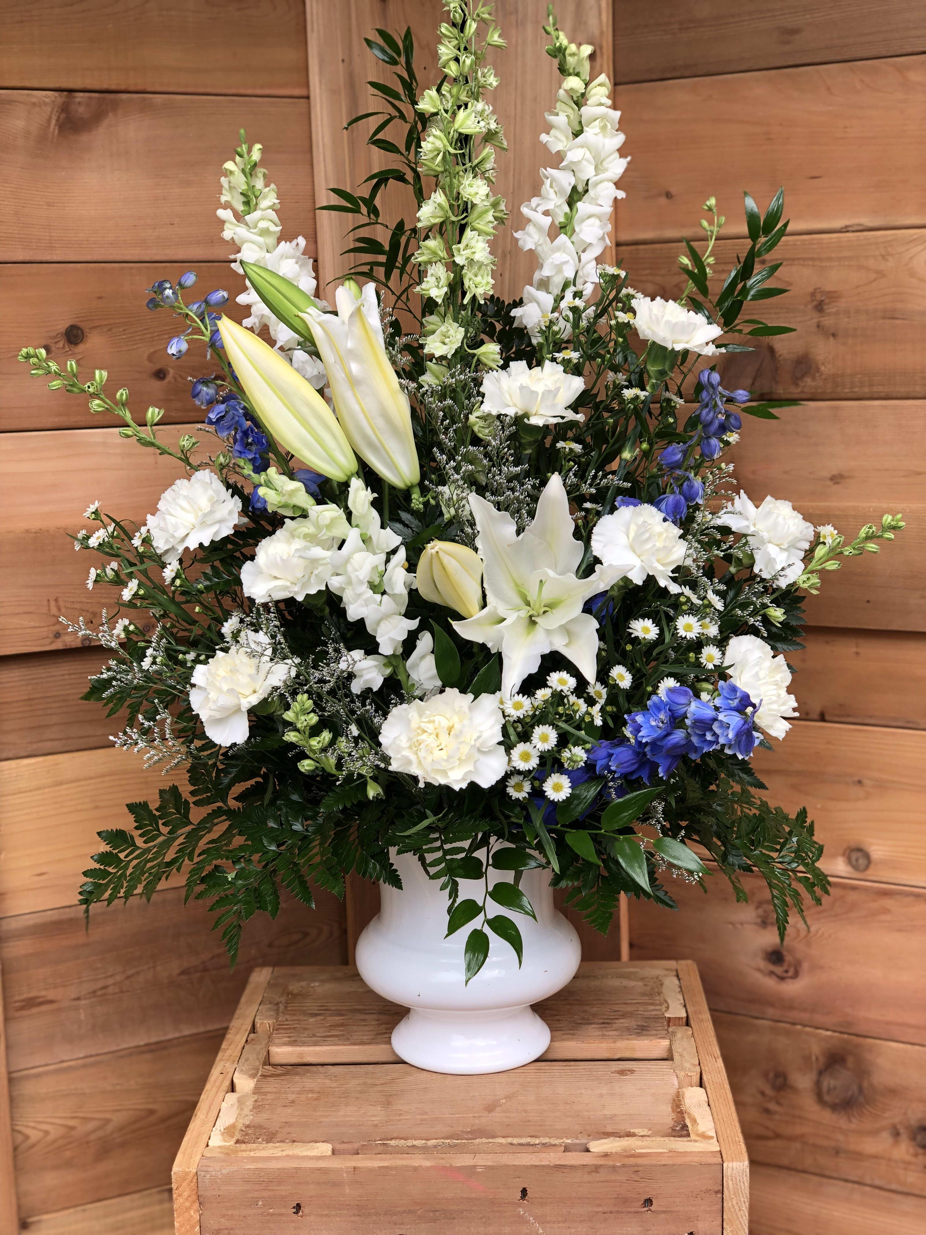 Blue And White Urn Flower Arrangement By Gateway Florist