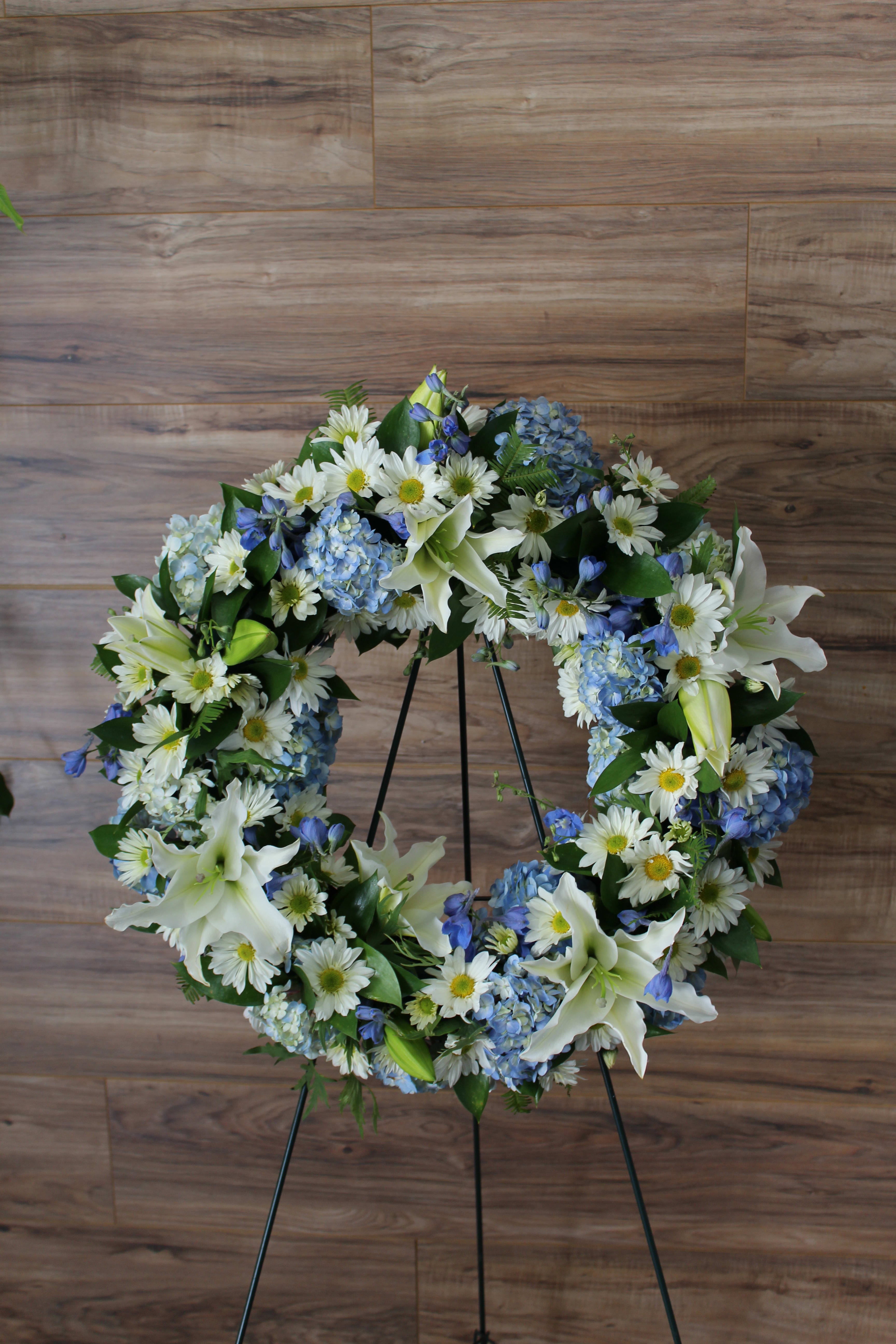 Blue And White Funeral Wreath By Genesee Florist And Events