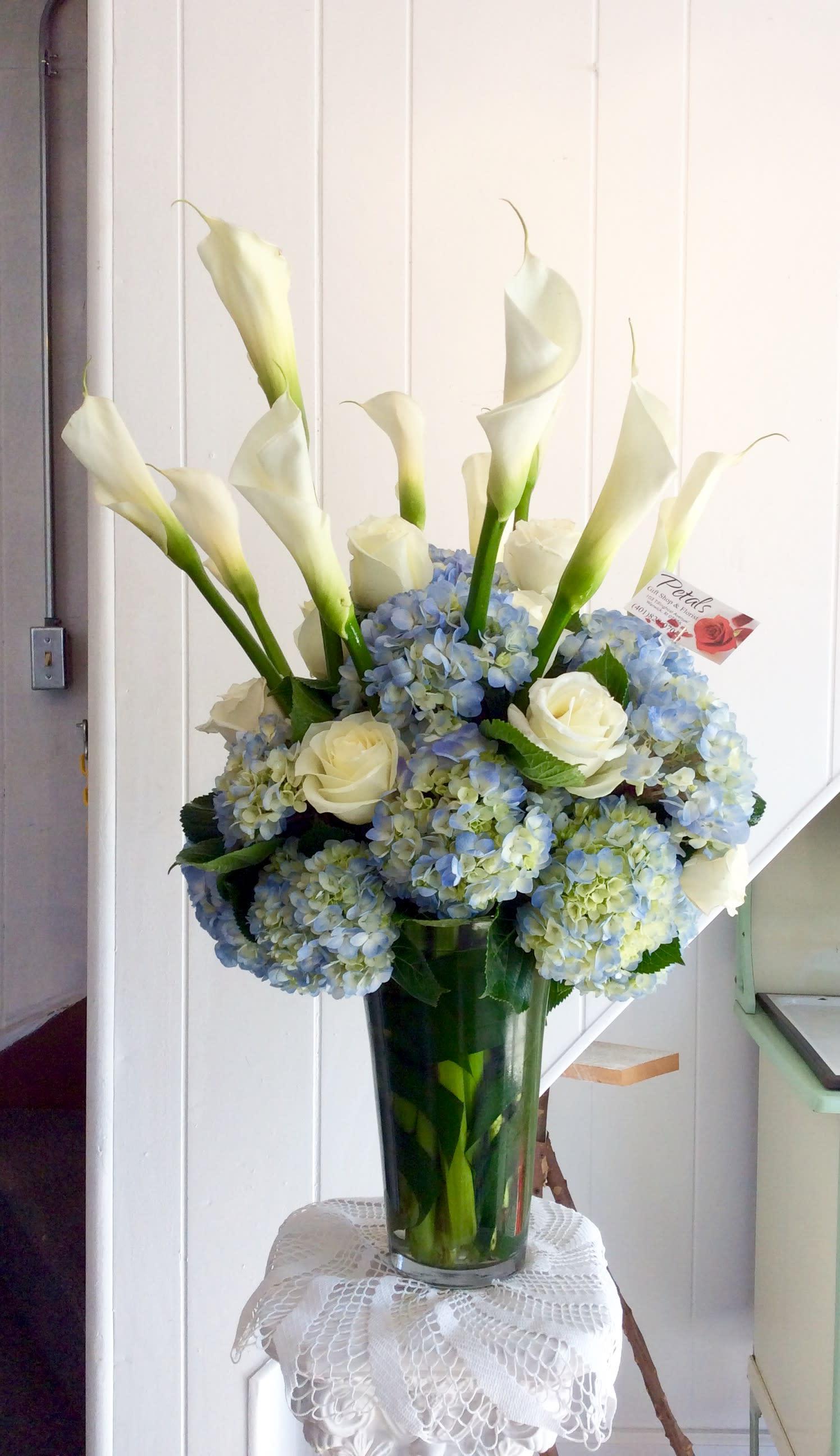 Awe Inspiring Tall Vase Of White Cala Lillies Roses And Hydrangeas In Warwick Ri Petals Florist Gift Shop