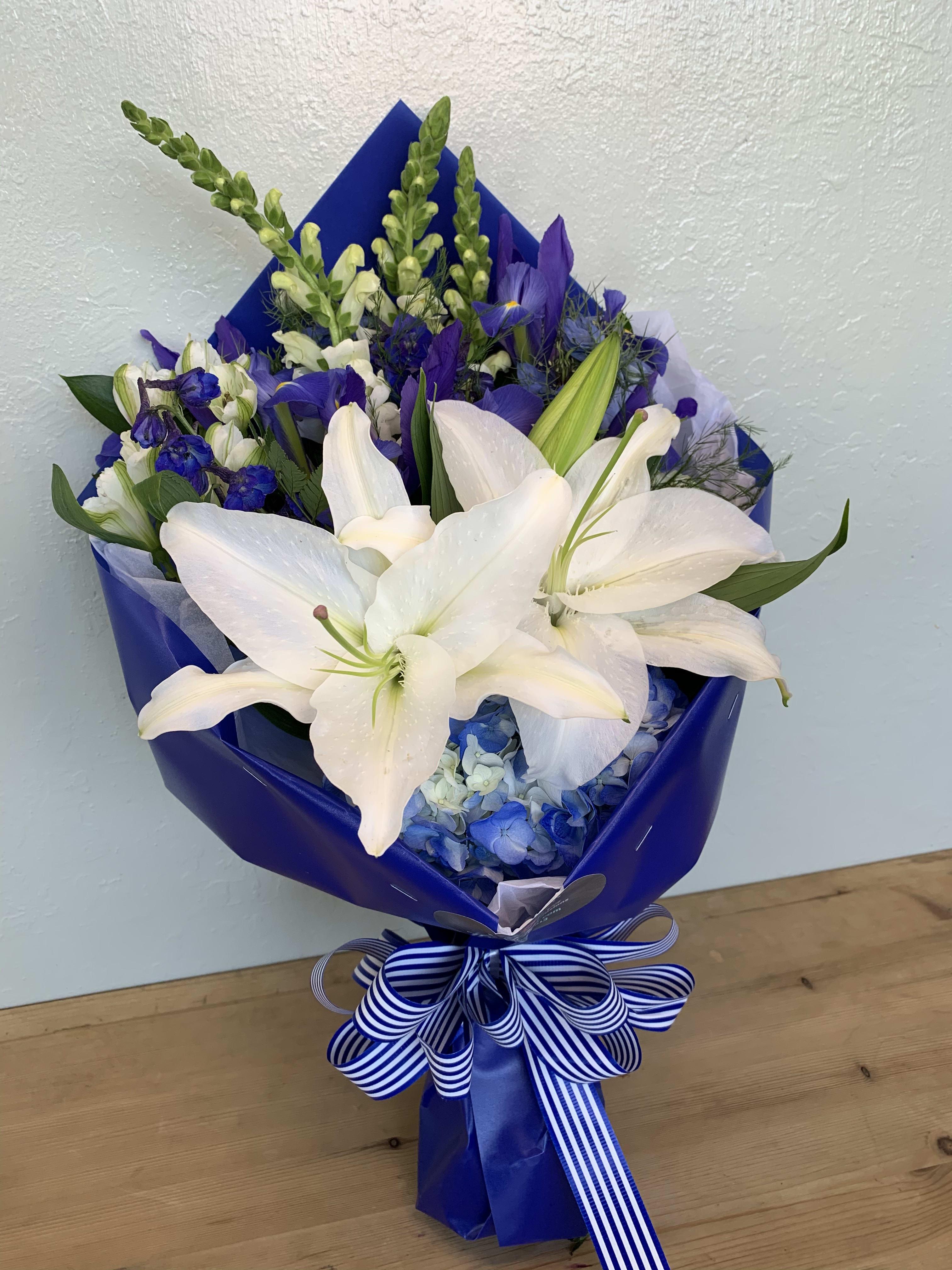 Blue White Flowers Wrapped Bouquet By La Floriya
