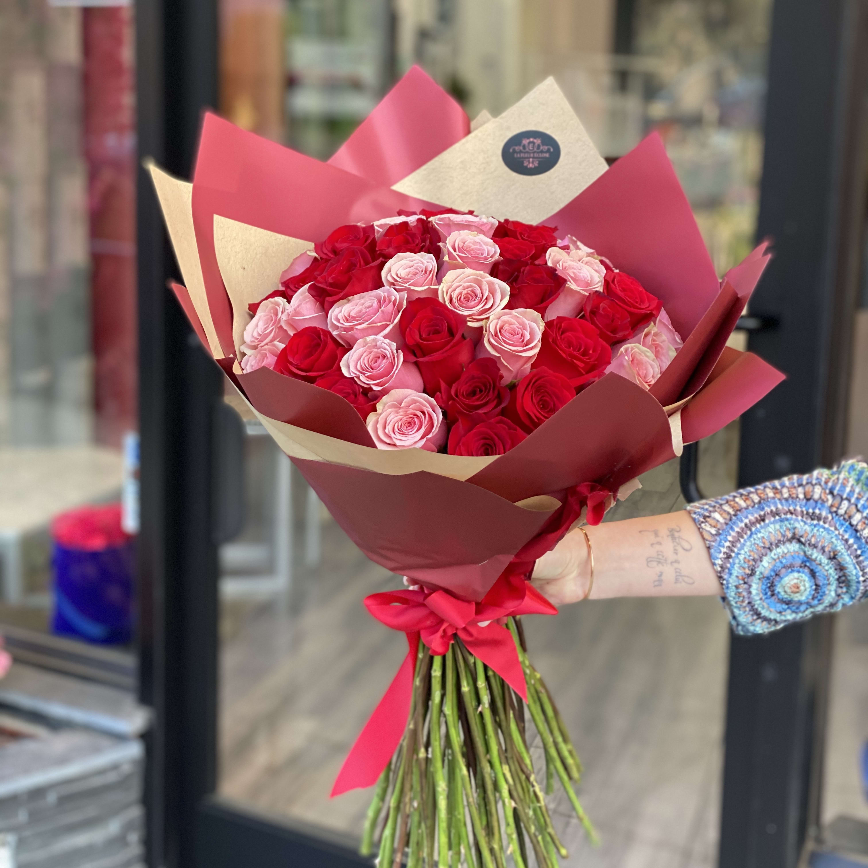 Hand Bouquet With 50 Pink And Red Roses By La Fleur Eclose